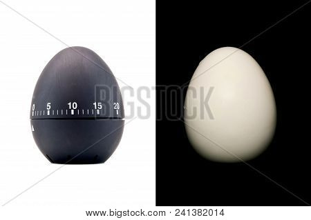 Timer as a black egg isolated on white background and boiled peeled egg on a black background stock photo
