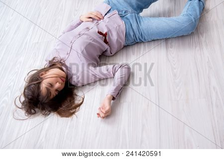 Dead woman on the floor after commiting suicide stock photo