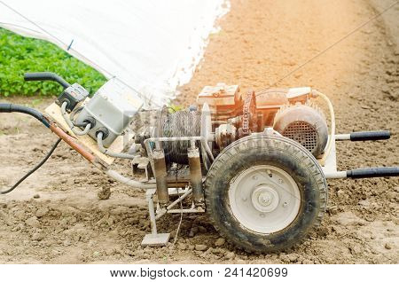 electric winch or cultivator for of agricultural work, farming, cultivation, agro-industry, the chain mechanism and gear stock photo
