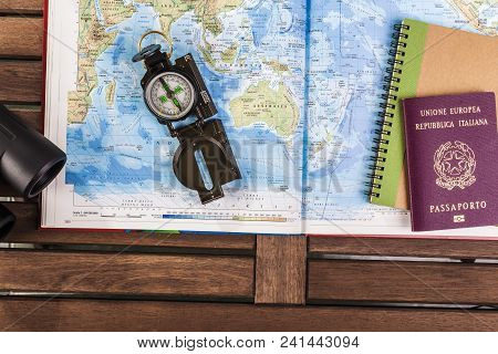 Travel planning. Compass, passport and block notes on map stock photo