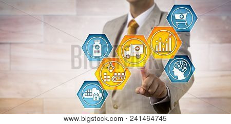 Unrecognizable pharmaceutical logistician activating icons for predictive analytics, materials handling and transportation. IT concept for supply chain management and pharma business logistics. stock photo