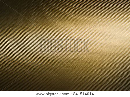 Metallic shiny texture of gold carbon fiber self-adhesive paper. Material for racing car modification. Material design for background, graphic design stock photo