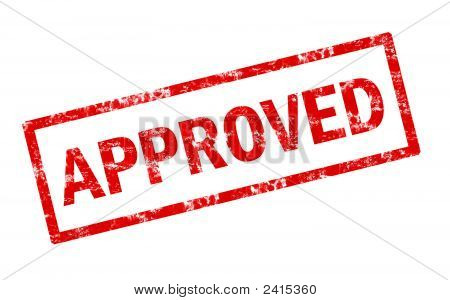 A grunge red stamp of thew word approved stock photo