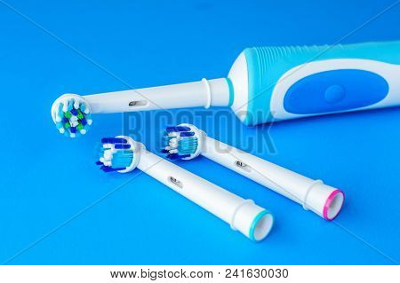 Electric Toothbrush on blue background, close up. Dental care tools stock photo