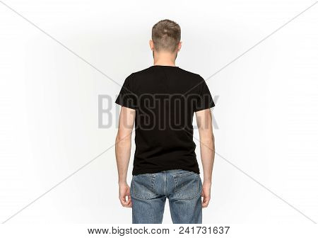 Closeup of young man's body in empty black t-shirt isolated on white background. Clothing, mock up for disign concept with copy space. Advertising concepts. Back view stock photo