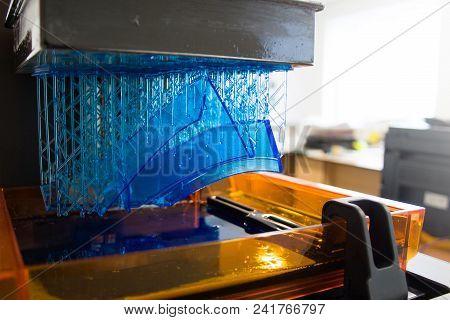 3D printing process. Modern 3D print technology. Working 3d printer machine printing a detail. Close-up. stock photo