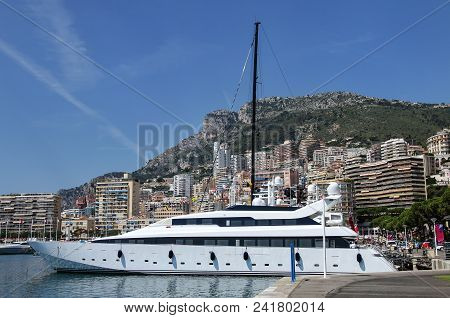 Yacht docked at Port Hercules in La Condamine ward of Monaco. Port Hercules is the only deep-water port in Monaco stock photo