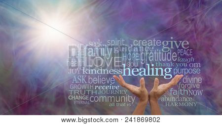 Shine your healing light word cloud - female hands reaching up to the word HEALING surrounded by a relevant word cloud with a sun burst and wispy multi colored energy field background stock photo