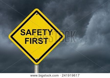 Safety First Warning Sign, Yellow Warning Sign With Words Safety First Warning With Stormy Sky Backg
