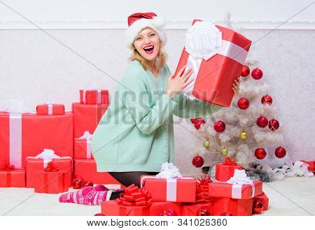 Perfect gift for girlfriend or wife. Give her gift that she always wanted. Woman excited blonde hold gift box with bow. Opening christmas gift. Girl near christmas tree happy celebrate holiday stock photo