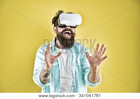 Cyber sex. Virtual sexual activity. Man touch virtual breasts. Explore cybersex. Play virtual sex game. Intimate sensation concept. Hipster man play sex game hmd or vr glasses. Satisfaction enjoyment. stock photo