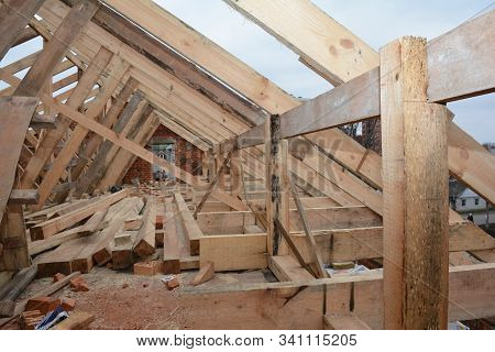 Unfinished attic  house rooftop roofing construction attic trusses, frame wooden beams, eaves, timber. stock photo