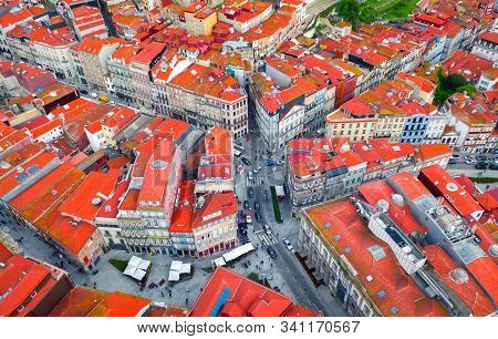 crossroads or road junction in a European city, red roofs top view, portuguese houses and architecture stock photo