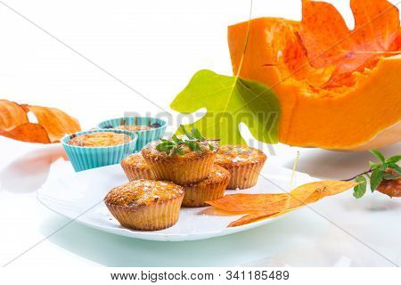 baked sweet pumpkin muffins with dried apricots inside stock photo