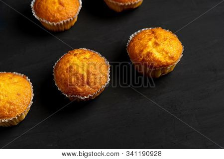 Appetizing muffins stand on a table top view. stock photo