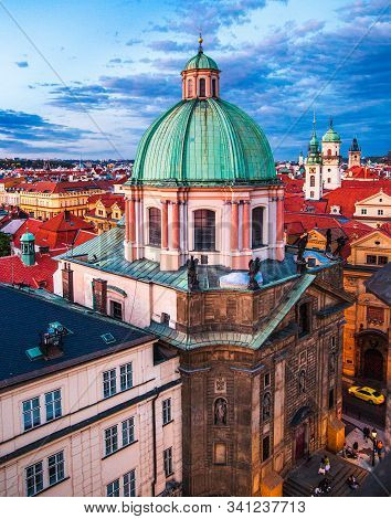 Church of St. Francis of Assisi in Prague. Top view from the Old Town Bridge tower on a Cloudy sky stock photo