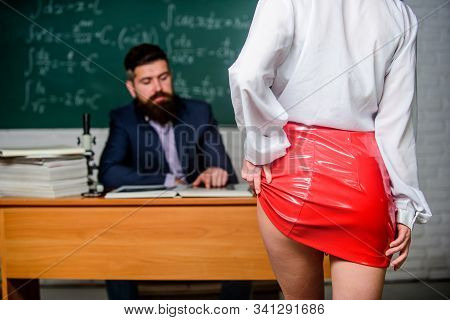 Passion for knowledge. Woman strip with passion in class. Sexy female buttocks in red leather skirt. Selective focus. Inspiring sexual passion. Seduction and passion stock photo