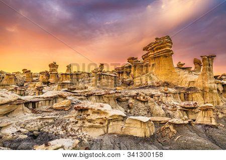 Bisti Badlands, New Mexico, USA hoodoo rock formations at sunset. stock photo