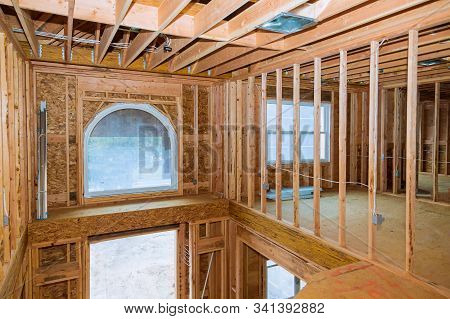 Framing beam of new house under construction home beam construction stock photo