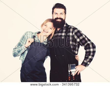 Picnic and barbecue. Backyard barbecue party. American food tradition. Cooking together. Couple in love getting ready for barbecue. Man bearded guy and girl ready for barbecue white background stock photo