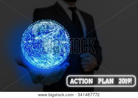 Writing note showing Action Plan 2019. Business photo showcasing proposed strategy or course of actions for current year Elements of this image furnished by NASA. stock photo