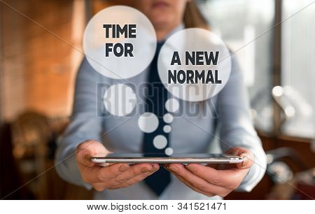 Conceptual hand writing showing Time For A New Normal. Business photo text Make a big dramatic change Replace the expected Woman in the background pointing with finger in empty space. stock photo