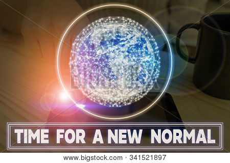 Writing note showing Time For A New Normal. Business photo showcasing Make a big dramatic change Replace the expected Elements of this image furnished by NASA. stock photo