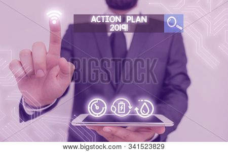 Writing note showing Action Plan 2019. Business photo showcasing proposed strategy or course of actions for current year. stock photo