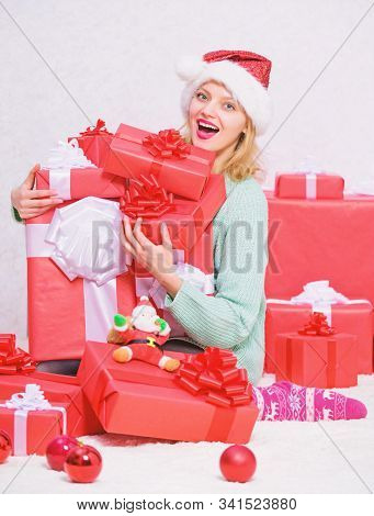 Perfect gift for girlfriend or wife. Opening christmas gift. Santa bring her gift that she always wanted. Girl near christmas tree happy celebrate holiday. Woman excited blonde hold gift box with bow stock photo