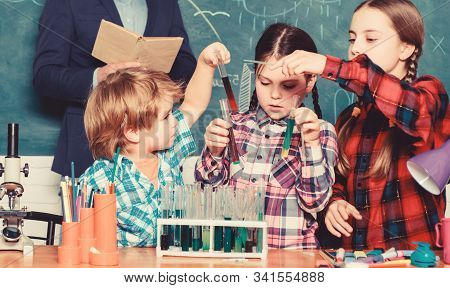 With experience comes knowledge. Formal education. Group interaction and communication. Promote scientific interests. Practical knowledge. Teaching kids sharing important knowledge. Chemistry classes stock photo