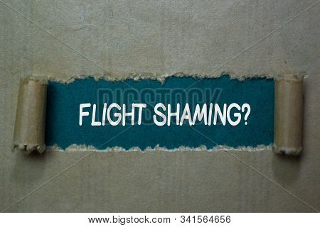 Flight Shaming? Text written in torn paper stock photo