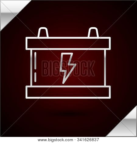 Silver line Car battery icon isolated on dark red background. Accumulator battery energy power and electricity accumulator battery. Lightning bolt. Vector Illustration stock photo
