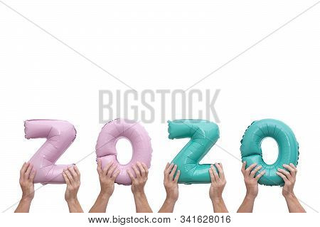 Hands holding numbers 2020 made of pink and mint foil balloons isolated on white background. Greeting card to celebrate 2020 Happy New Year with copy space stock photo