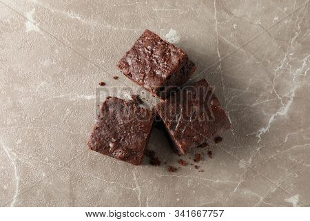 Chocolate cake slice and chocolate isolated on white background stock photo