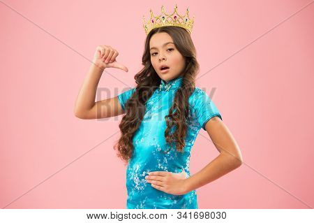 Little princess. Girl wear crown. Princess manners. Award concept. Winner of beauty competition. International beauty contest. Kid wear golden crown symbol of glory. Beauty pageant. Focus on beauty. stock photo