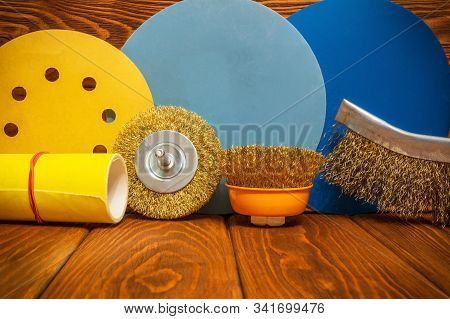 Set of abrasive tools different colors and yellow sandpaper on vintage wooden boards wizard is used for grinding items stock photo