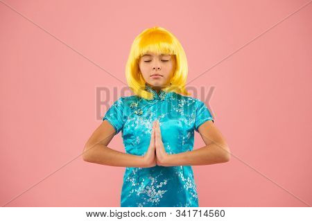 Eastern trends for teens. Hobby and entertainment. Pop culture. Anime fan. Cosplay kids party. Child cute cosplayer. Cosplay outfit. Otaku girl wig smiling pink background. Cosplay character concept. stock photo
