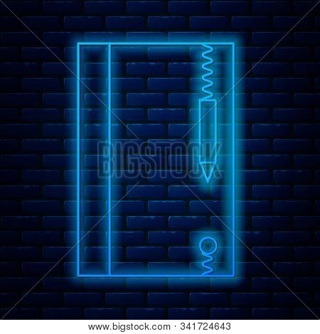 Glowing neon line Underwater note book and pencil for snorkeling icon isolated on brick wall background. Water writing slate or tablet with pen. Vector Illustration stock photo