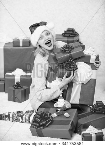 Woman excited blonde hold gift box with bow. Perfect gift for girlfriend or wife. Opening christmas gift. Santa bring her gift that she always wanted. Girl near christmas tree happy celebrate holiday stock photo