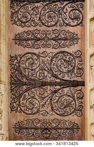 Ornament twirly metal fittings on ancient medieval door of cathedral of the Notre-Dame, Paris stock photo