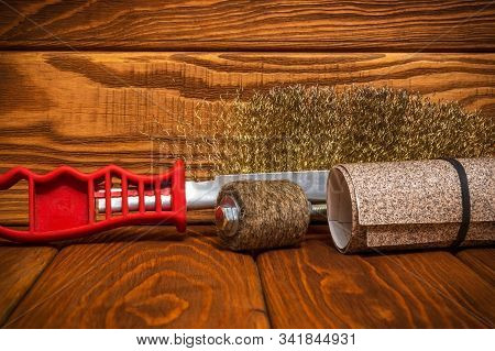 Set of abrasive tools and sandpaper on vintage wooden boards wizard is used for grinding items stock photo