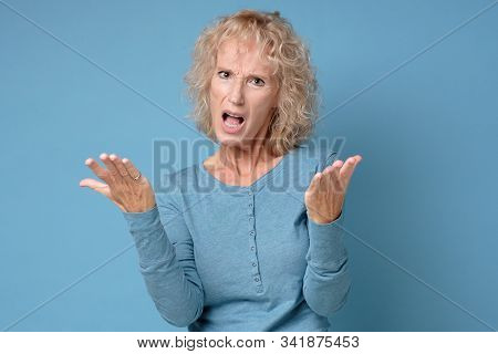 Angry woman unhappy, annoyed by something. Negaative facial human emotion. stock photo