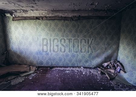 Wall in abandoned apartment in Skrunda 1 Soviet military ghost town and former radar station located in Latvia stock photo