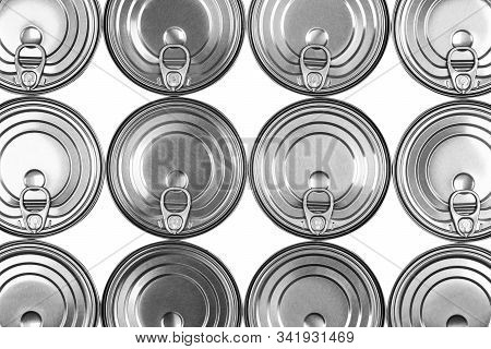 Close up photo of aluminium cans in a raw isolated on white background. Aluminium can background. Can Pattern. Aluminium beverage cans. Drink can. Metal containers for packaging drinks. stock photo