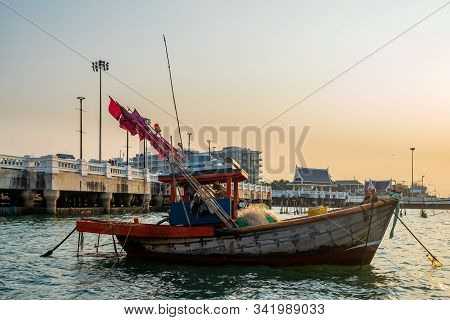Close up Fishing wood boats floating down or park at seaport while sunset in asia stock photo