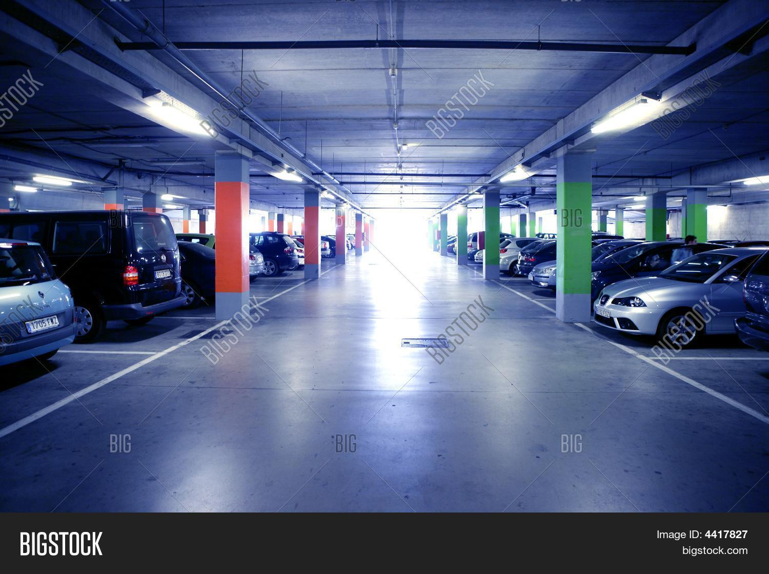architecture,auto,automobile,basement,building,business,car,cement,city,concrete,corridor,dark,downtown,drive,empty,floor,garage,gray,group,horizontal,illuminated,indoors,interior,large,life,lights,metal,modern,new,park,parking,perspective,public,road,scene,signs,structure,technology,traffic,transport,transportation,travel,urban,vehicle,wall,window,yellow