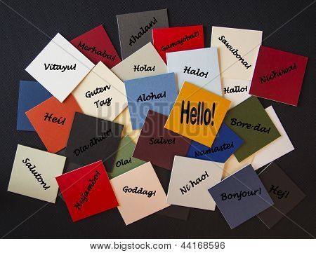 Hello Bonjour Nichiwa Guten Tag! Hello in different languages -as a sign, poster, label or sticker design for business or public relations. stock photo