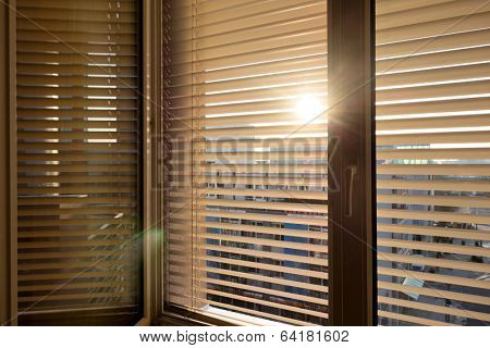 to protect against heat and sun blinds are attached to a window. stock photo