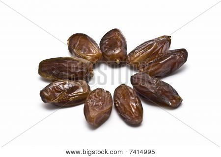 Some natural dates isolated on a white background. stock photo