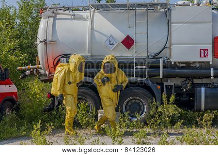 Mans with briefcase in protective hazmat suit